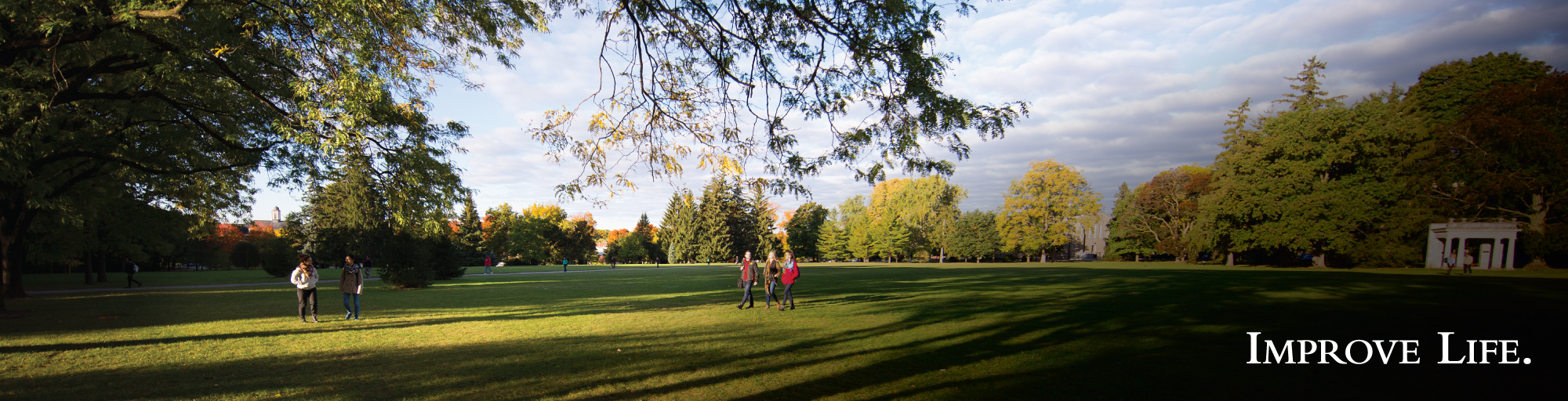 Students walking across Johnston green