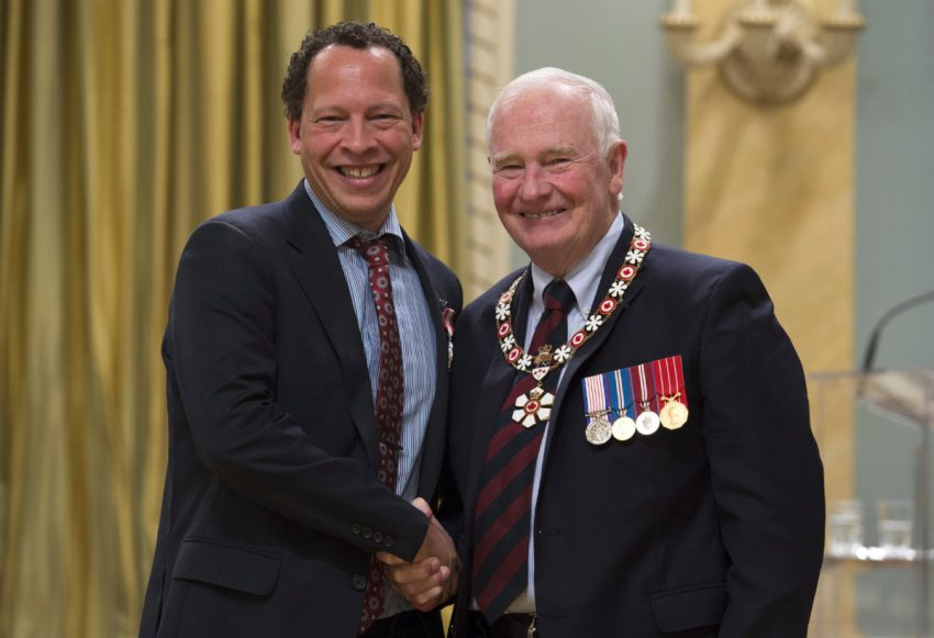 Lawrence Hill receiving the Order of Canada award.