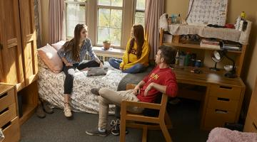 Three students relaxing in a residence room at U of G.